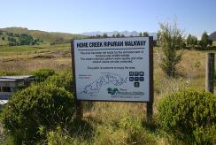 Signage and fencing at Home Creek reserve.